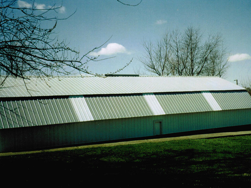 Hog Shed After Completion With New Siding, Roof Skylights, And Doors.