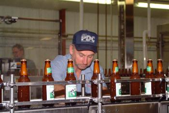 Perry inspecting the bottling line.